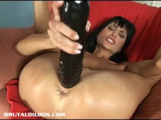 Gorgeous dark haired European babe fills her pussy with a giant dildo