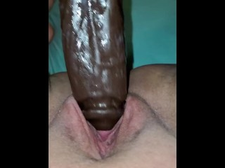 Beautiful wet pussy squirting from her giant black dildo