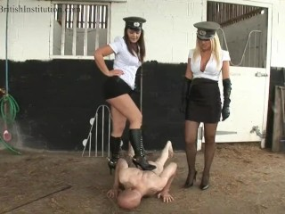 Two british beauties with high heels torture their slave outdoor - 02