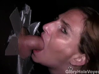 Redhead MILF blows Two dicks in Glory Hole