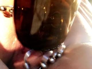 Insertion milkbottle in huge pierced pussy