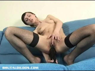 Short haired Russian filling her butt with a brutal dildo