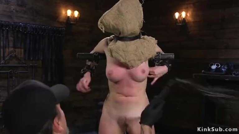Hooded slave in device bondage whipped