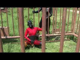 Bizarre Rubbergirls With Latex Catsuit + Heavy Gas Mask + Gloves + Piss Bag