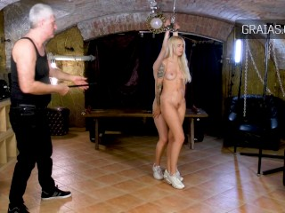 Sexy blonde teen girl in BDSM scene
