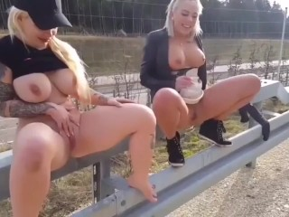 Two german beauty's pissing outdoor.
