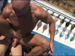 Blonde at outdoor swimming pool pegging guy with strapon in the prostate