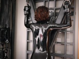 Punish spank in latex catsuit